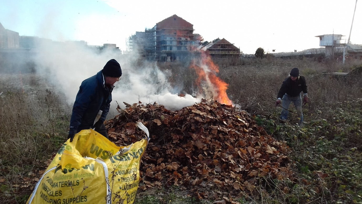 Volunteers burning dry leaf pile after cleaning up at LSP