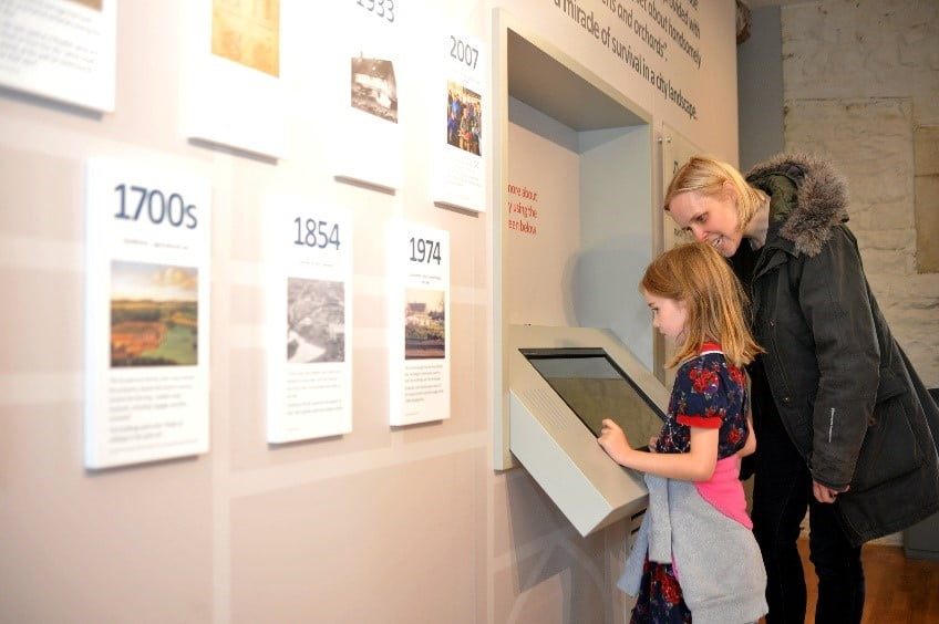 Visitors interacting with heritage display